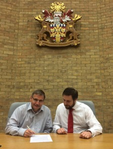 Lib Dem Leader Cllr Douglas McCall and Labour Leader Cllr Pete Marland signing the agreement.